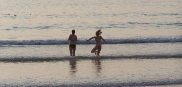 North Cornwall self catering girls in surf
